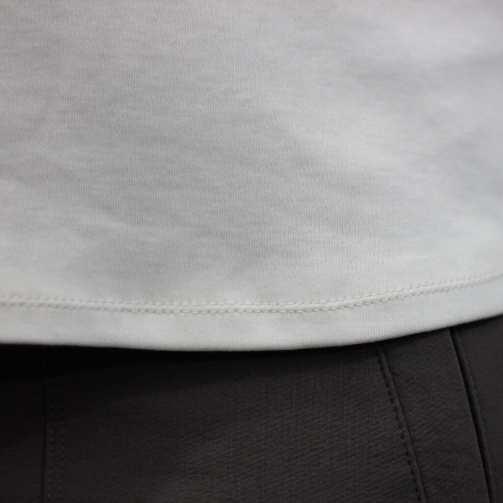 close-up image of the finished sewn top, showing the stitching made using a twin needle
